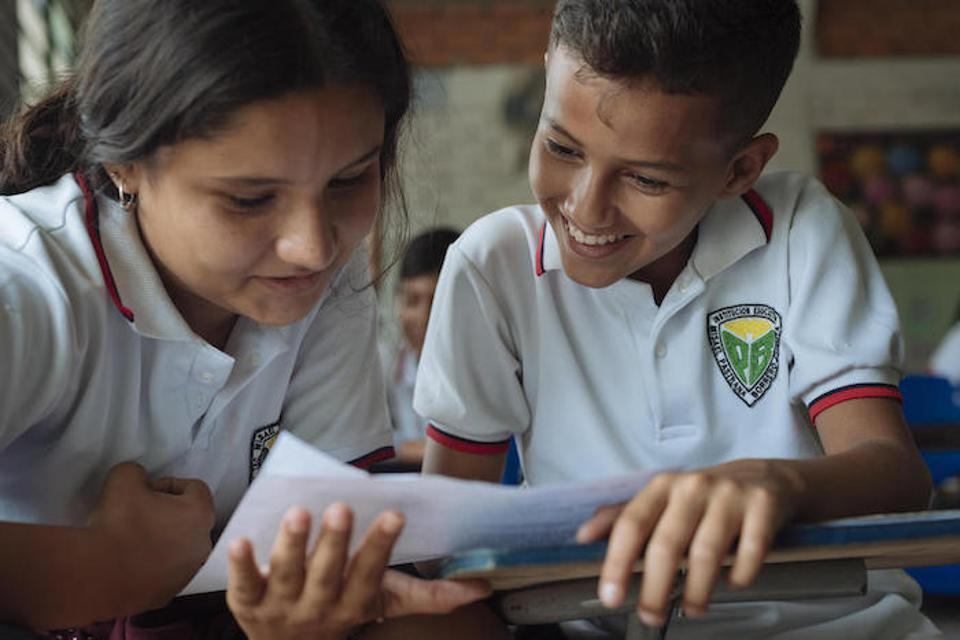 In Cucuta, Colombia, students attend class at the Misael Pastrana School where about 70% of the students are Venezuelans who cross the border every morning to attend.