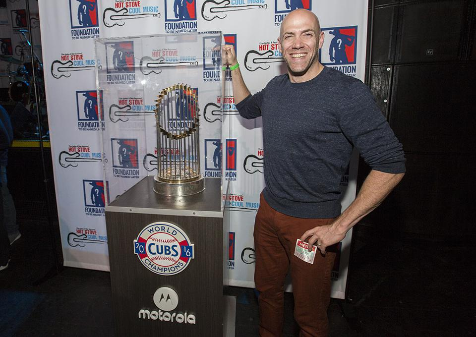 Foundation To Be Named Later co-founder Paul Epstein poses with the 2016 Chicago Cubs World Series Trophy. Friday, June 8, 2019 during the Hot Stove Cool Music benefit concert at Metro in Chicago.