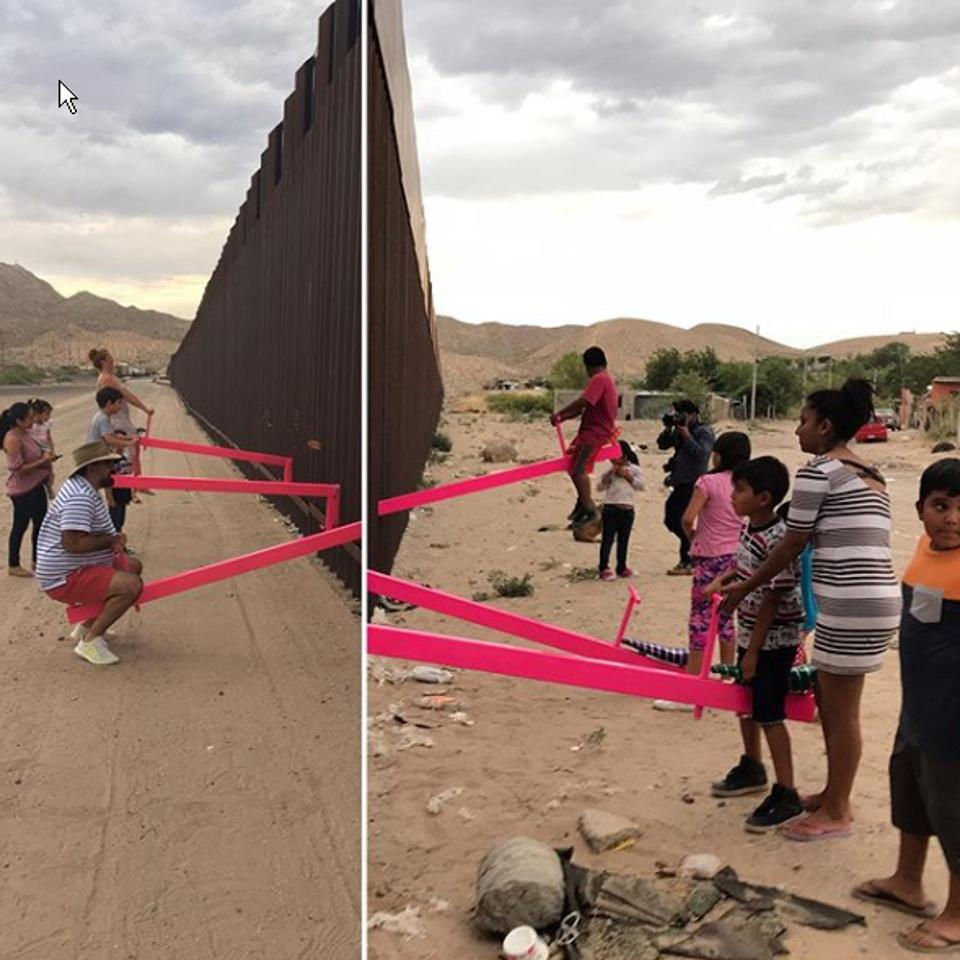 Ronald Rael and Virginia San Fratello installed hot pink seesaw at the Us-Mexico border on Saturday.