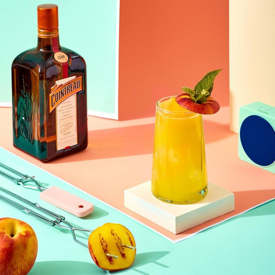 A margarita, grilled peaches and a bottle of Cointreau.