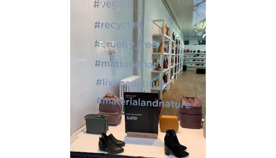 Shoe shop glass with hashtags