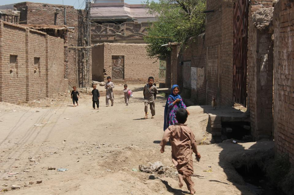 Children playing in the streets in Peshawar, Pakistan, May 16, 2016.