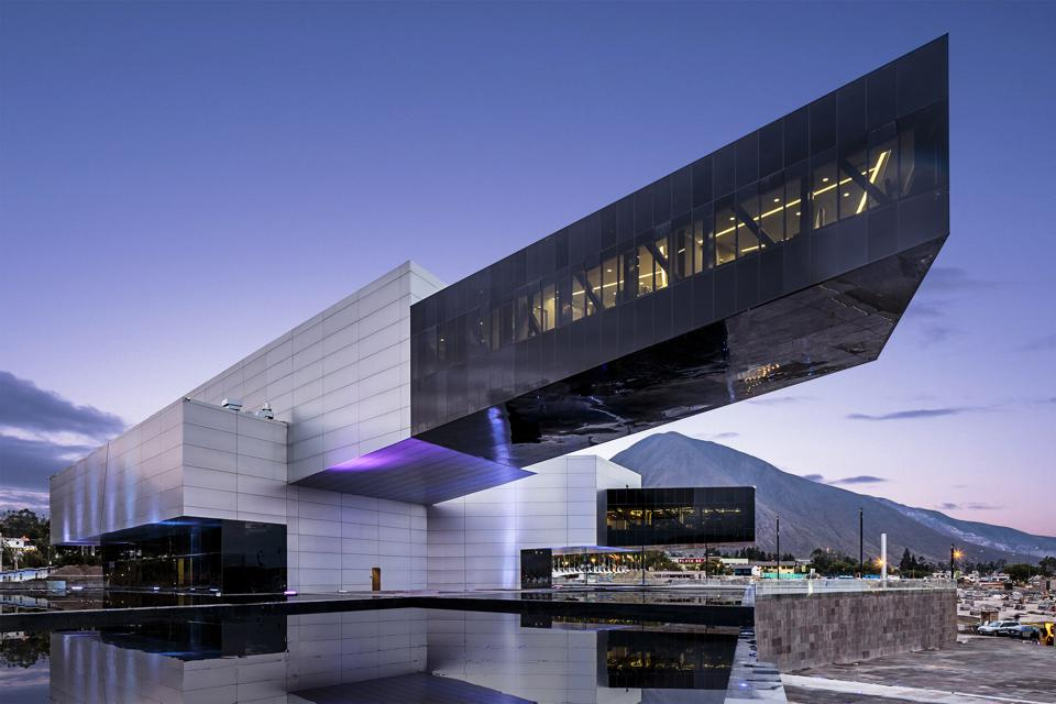 The UNASUR HQ and its impressive cantilever set against Ecuador's Andes mountains