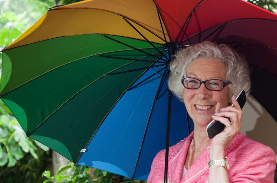 Peggy King using a 2G mobile phone