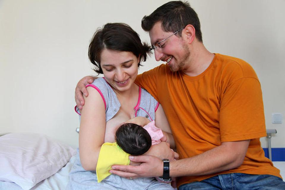 Parents of a newborn photographed at the maternity ward of a UNICEF-supported hospital in Yerevan, Armenia. Fathers, husbands and partners can play a critical role in supporting breastfeeding — a lifesaving practice that benefits mother and child.
