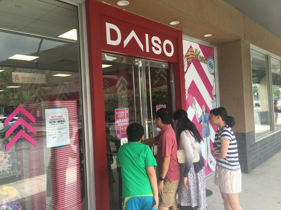 A photograph of shoppers waiting to enter the newest Daiso discount store on the East Coast, in Edgewater, N.J. on Friday, August 2, 2019