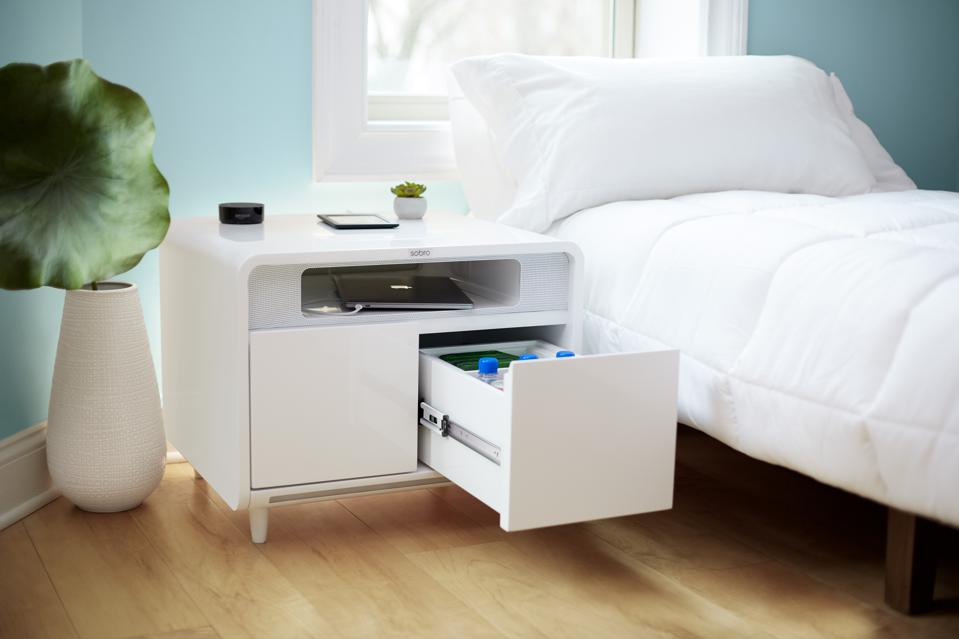 This second generation night table  has a cooler drawer, wireless charging, Bluetooth speakers, motion sensor lighting, cable management, accent lighting, and charging/power ports.