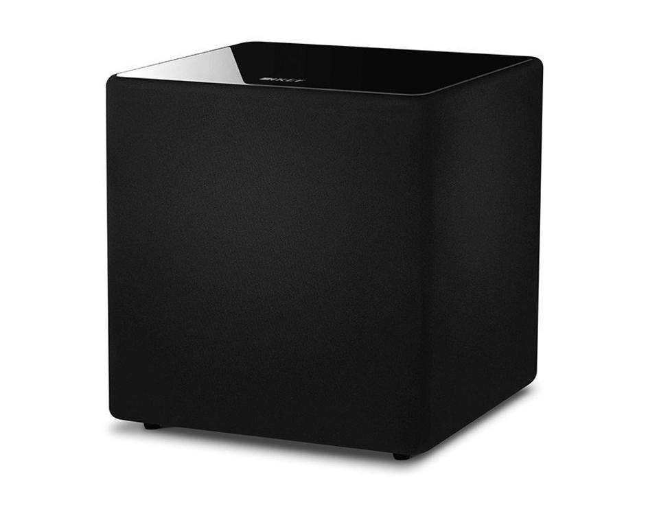 The KEF KUBE 12b subwoofer is equally happy tucked away or showing off its glossy finish.