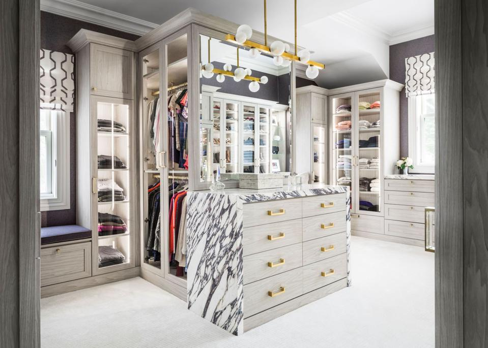 Luxury closet with lighting and cabinetry