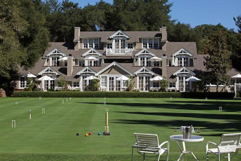 The gracious croquet lawn at Meadowood with the Lodge in the background