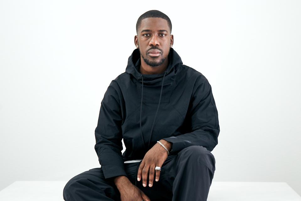 Creative director, designer, and streetwear label Hymne founder Jide Osifeso.