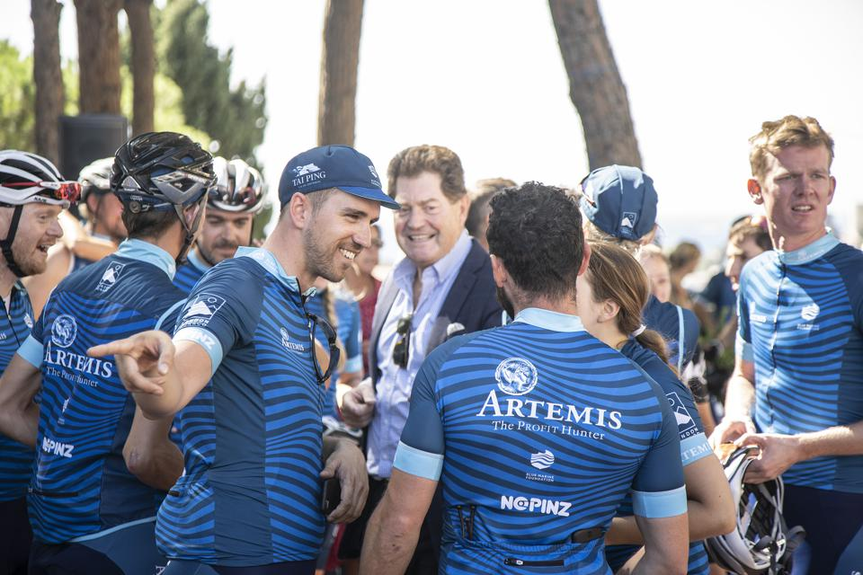Andrew Winch (center) with his team at the finish of the 2018 London to Monaco ride.