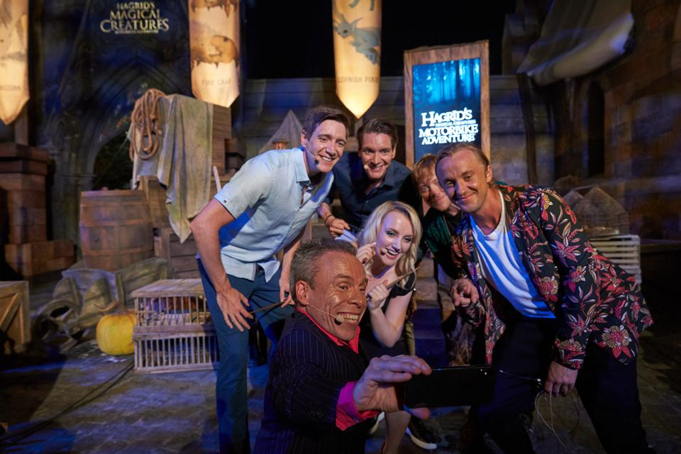 Movie stars James and Oliver Phelps with Warwick Davis (left), Evanna Lynch, Rupert Grint (second from right) and Tom Felton celebrate the opening of the new ride