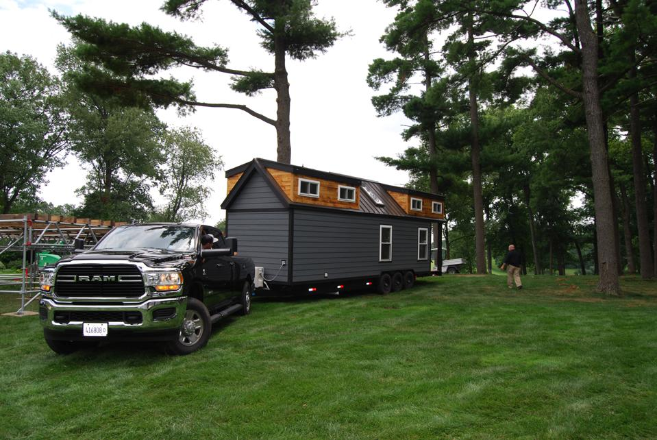 The Tiny House is easily transported to its location near the 14th tee at Medinah Country Club.