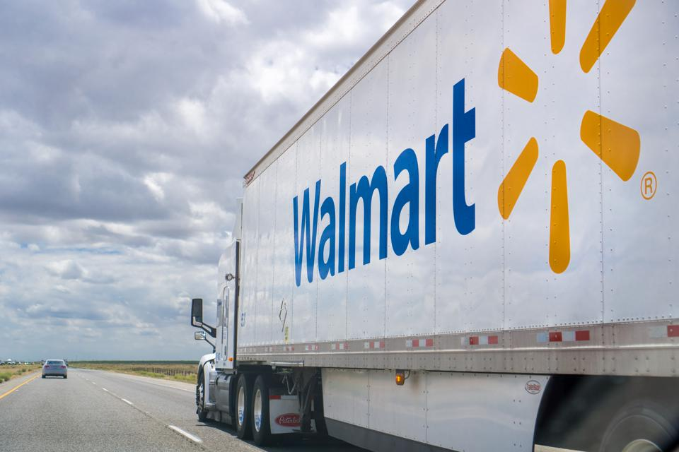 Walmart truck driving on the interstate on a cloudy day in California.