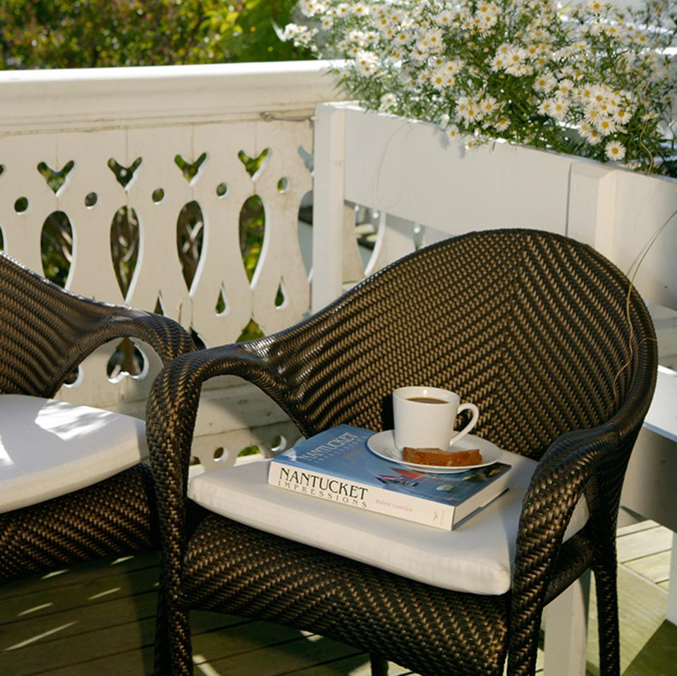 Guests can relax and read on the Veranda porch.