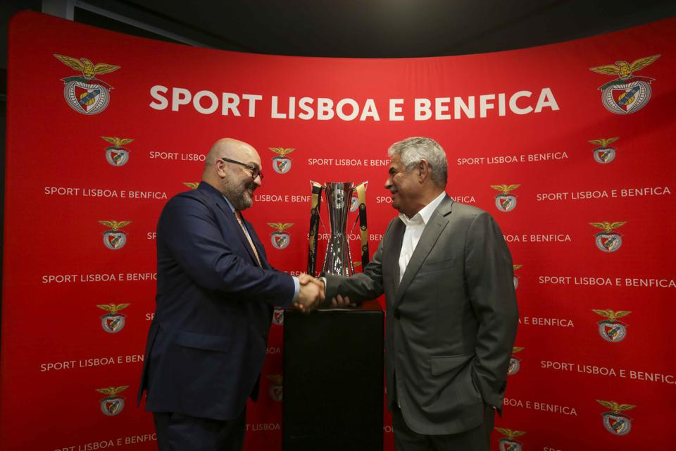 Relevent Sports Group executive chairman Charlie Stillitano presents Benfica president Luís Filipe Vieira with the 2019 International Champions Cup trophy.