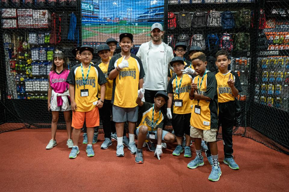 Philadelphia Phillies outfielder Bryce Harper with members of North Camden Little League.