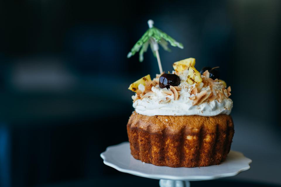 Rum cake with coconut frosting.