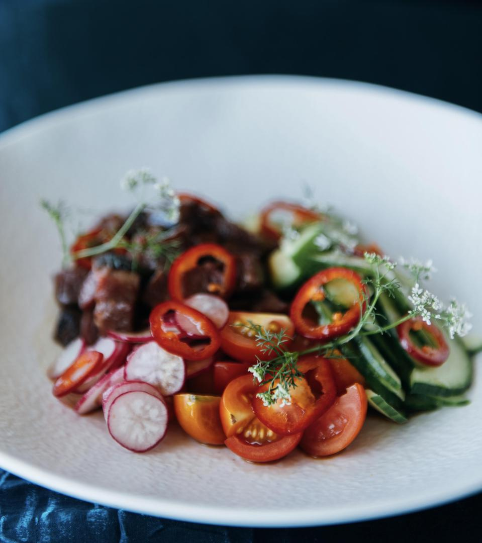 Beef poke with seared beef fillet, sesame lime dressing, radish and chili.