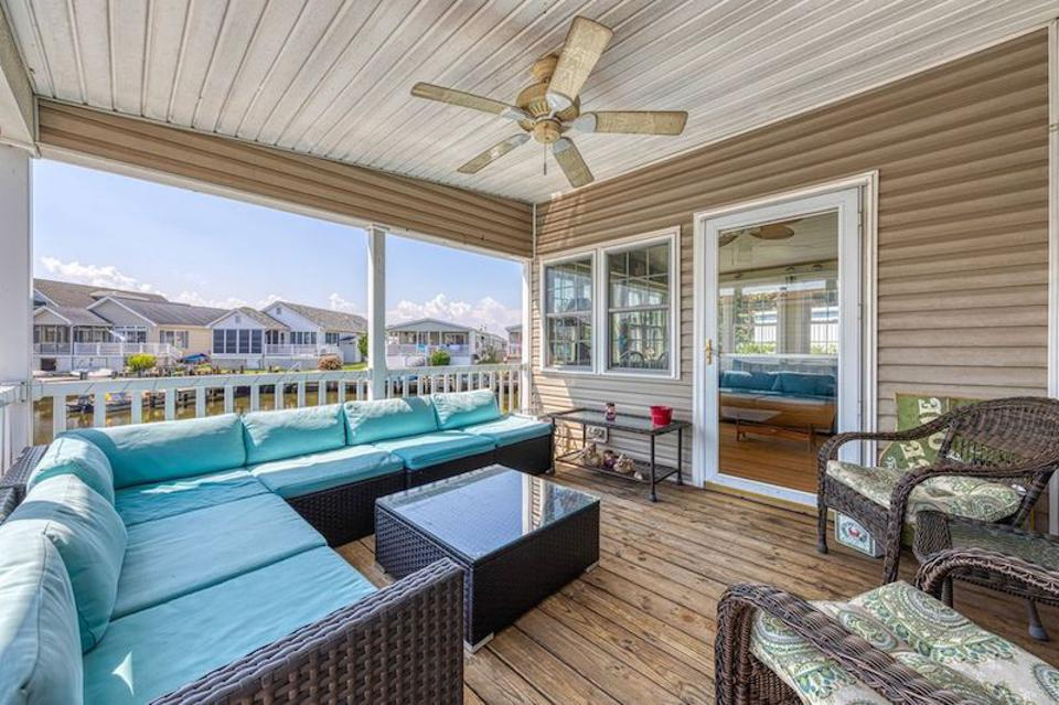 Spacious porch on 3-bedroom property in Ocean City, MD
