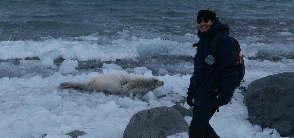 Colombian Historian Natalia Jaramillo (right), with seal on Livingston Island, in the Antarctic.