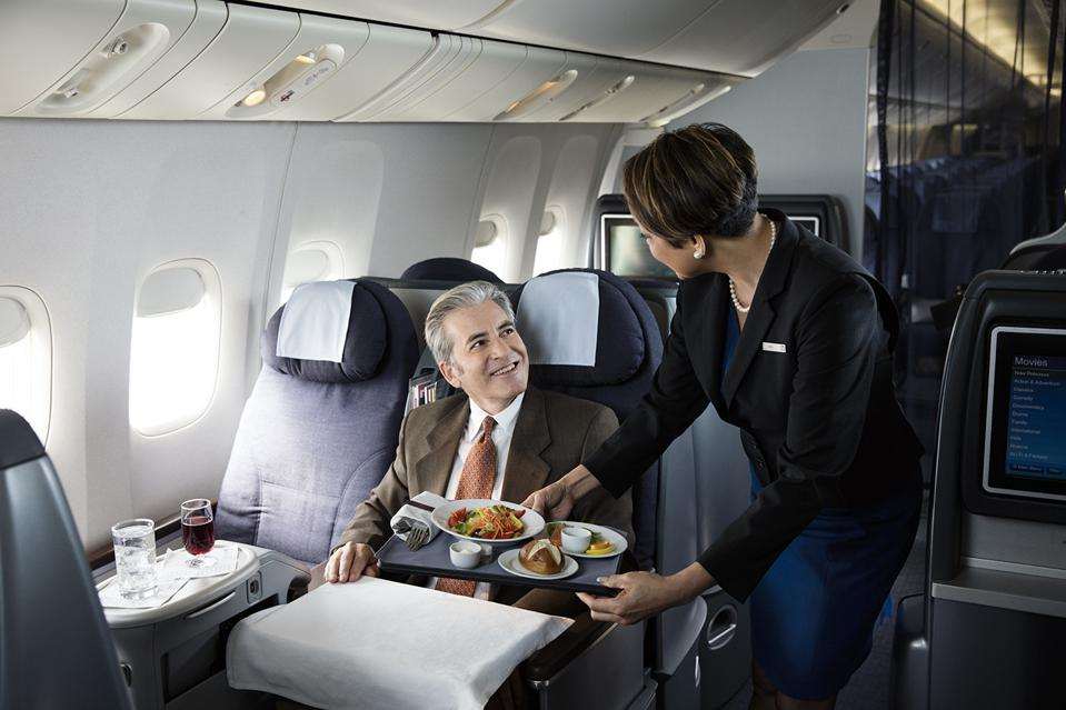 A United Airlines Flight Attendant serving food