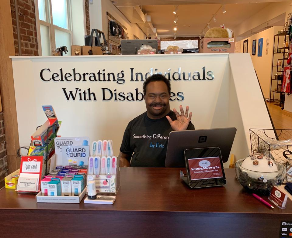 Eric Wells greets visitors at Something Different by Eric, a retail gift shop in Bryn Mawr, PA
