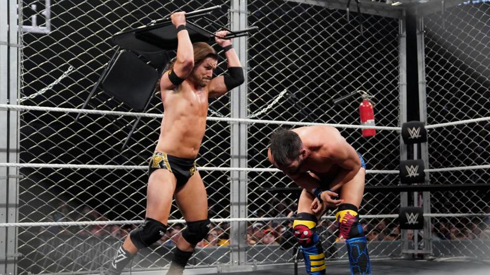 Adam Cole smashes Johnny Gargano with a chair at NXT TakeOver: Toronto.