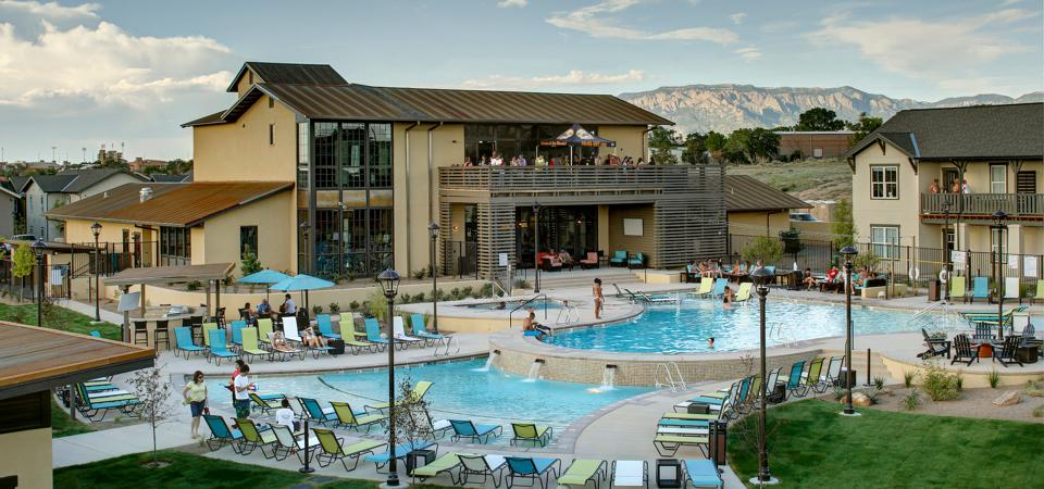 View of club house with swimming pool at the University of Albuquerque
