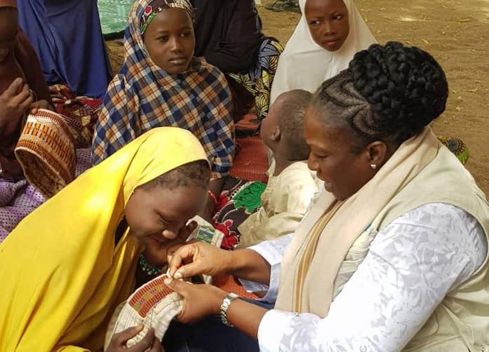 Miatta Abdullai Clark, far right, is a child protection worker in Maiduguri, Borno State, Nigeria.