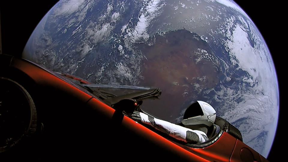 A mannequin dubbed 'Starman' wearing a SpaceX spacesuit takes in a unique view.
