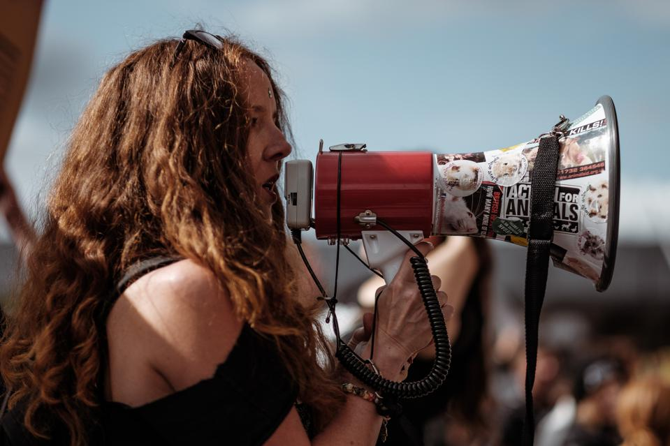 Woman speaking into a megaphone.