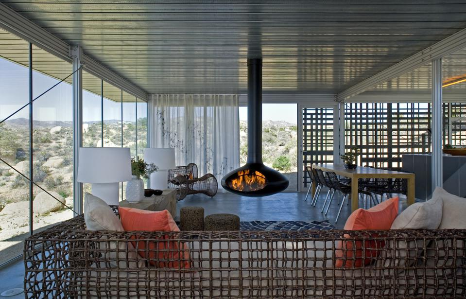 Heat is absorbed by the large glazing in this itHouse in Pioneertown, CA. The house was designed by Taalman Koch Architects