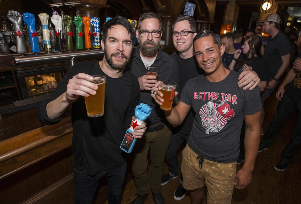 (Left to right) Pete Loeffler, Dean Bernardini and Sam Loeffler of hard rock band Chevelle join Revolution Pub Brewer John ″Jumpy″ Palos for the La Gargola Helles lager launch party. Thursday, August 1, 2019 at the Revolution Brewing Brewpub in Chicago (Photo by Barry Brecheisen)