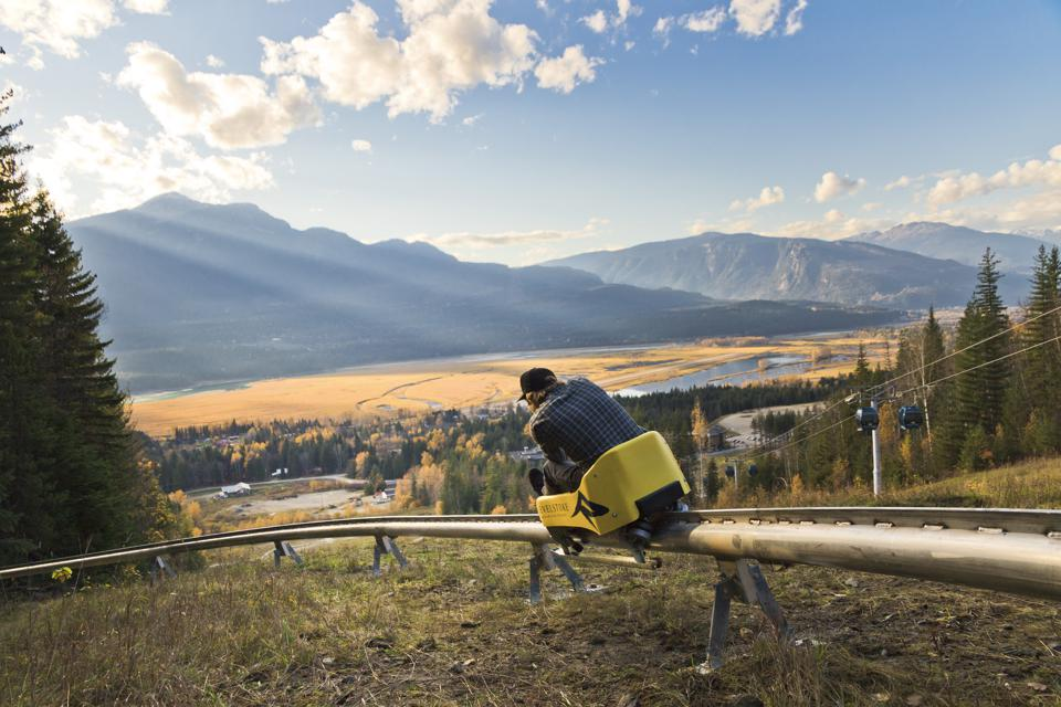 Fly through the forest on the mountain coaster at Revelstoke Mountain Resort.