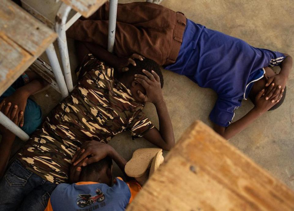 On June 26, 2019, children take part in an emergency attack simulation as they practice shelter and evacuation procedures in the event of an armed attack at the Yalgho Primary School in Dori, Burkina Faso.