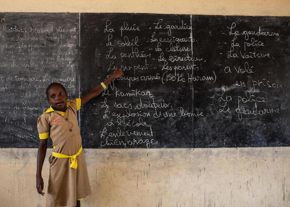 A student goes over blackboard notes for a class in emergency preparedness in case of armed attack at a school in Baigaï, a village near the Nigerian border in Cameroon's Far North region.