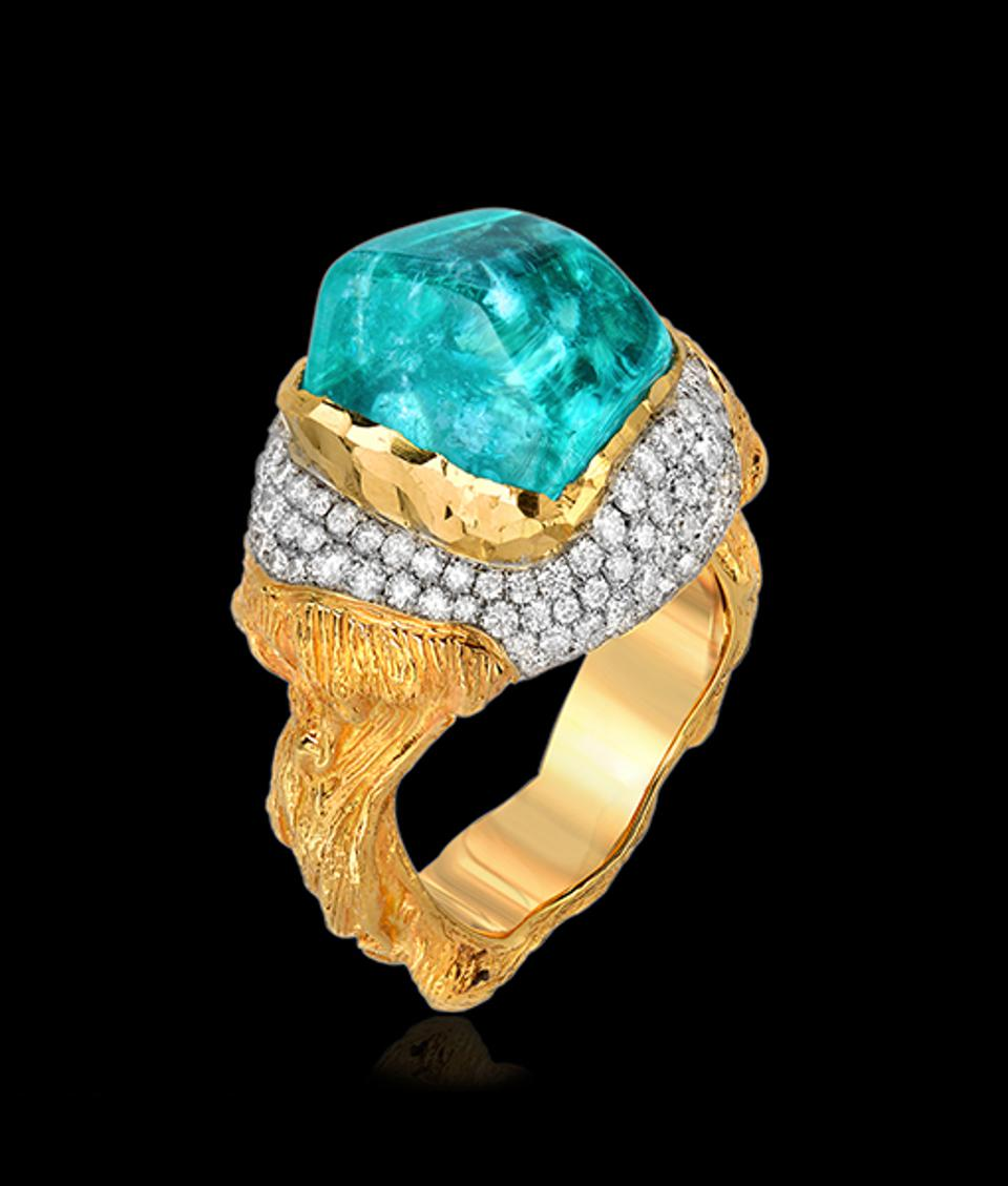 Natural diamonds add icy sparkle to a swimming pool blue Paraiba tourmaline ring by Los Angeles-based master jeweler Victor Velyan.