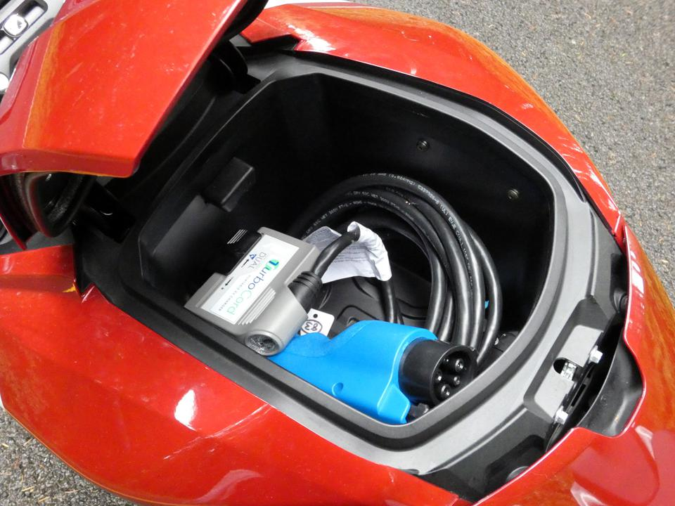 The included charger tucks into the SR/F's handy ″gas tank″ storage bin.