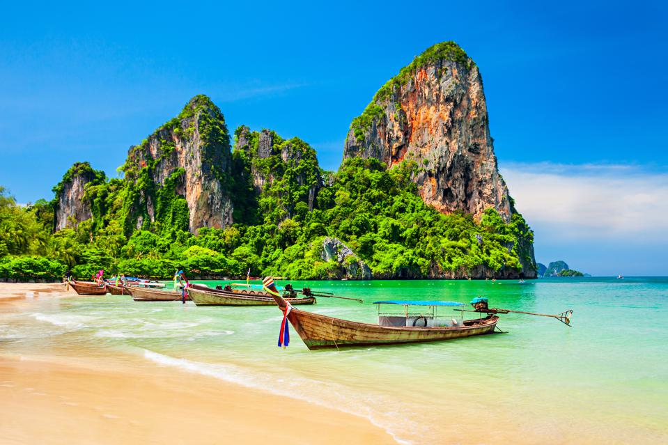 Thailand is known for this famous rock type that juts up hundreds of feet above crystal clear waters.