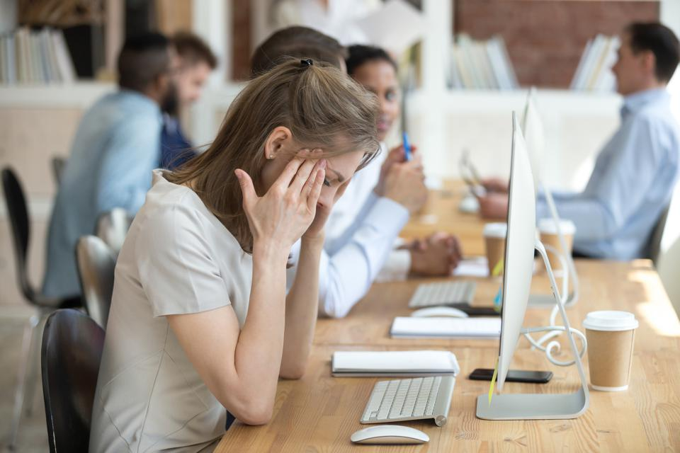 Frustrated employee working at computer