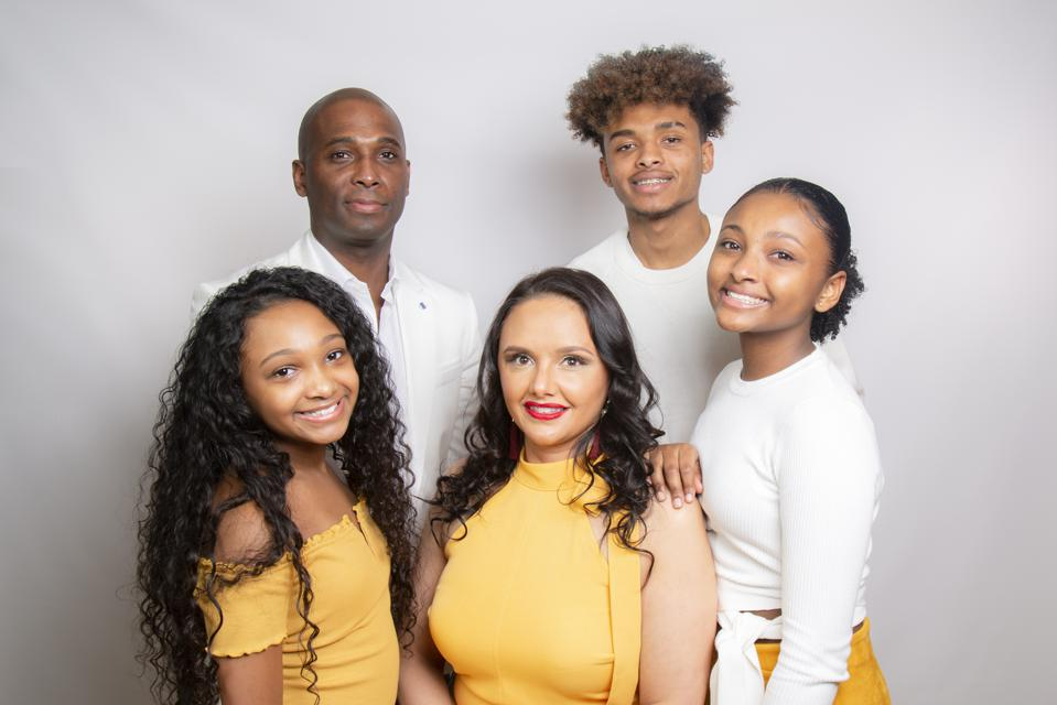 Aisha Ceballos-Crump, founder and CEO at Honey Baby Naturals, with her multiracial and multi-texture hair family,
