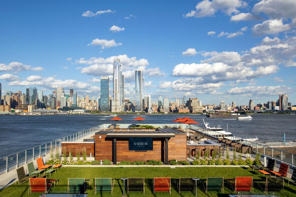 A roof deck with a view of the Manhattan skyline.