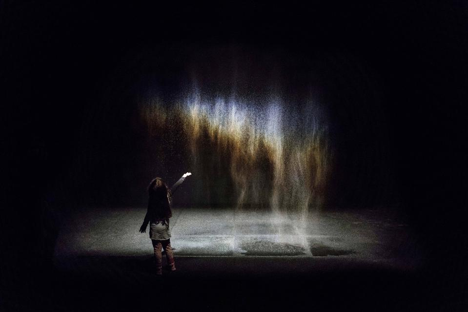 """Beauty"" (1993). Spotlight, water, nozzles, wood, hose, pump. Dimensions variable. Photo by Anders Sune Berg. Courtesy of the artist; neugerriemschneider, Berlin; Tanya Bonakdar Gallery, New York / Los Angeles © 1993 Olafur Eliasson"