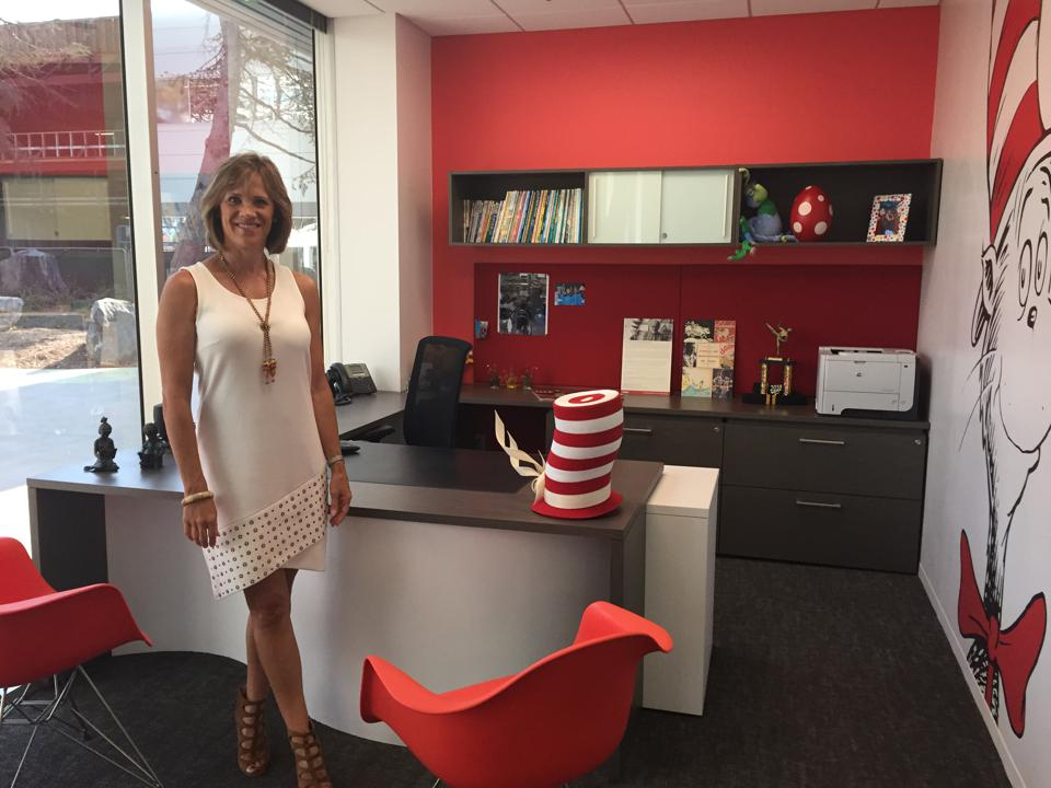 Brandt stands in her office among Dr. Seuss decorations.