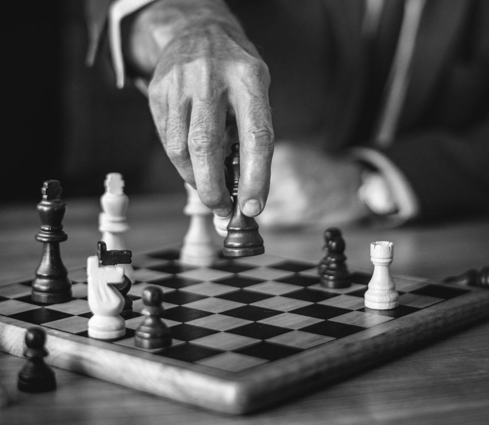 Man playing chess, strategy