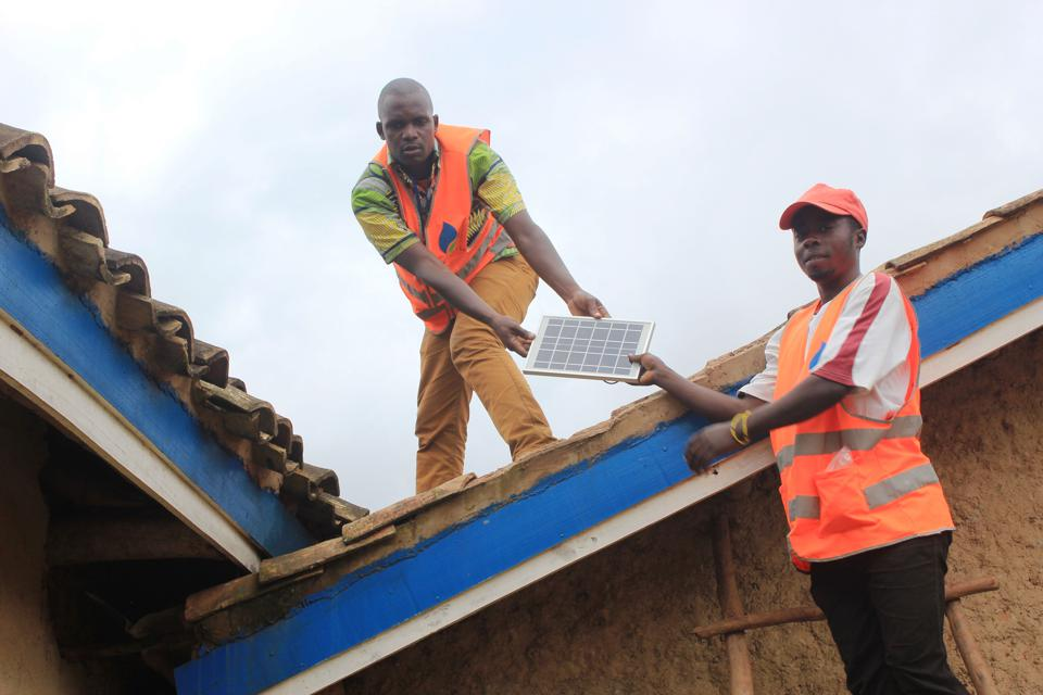 Solar panels being installed on rooftops in Africa