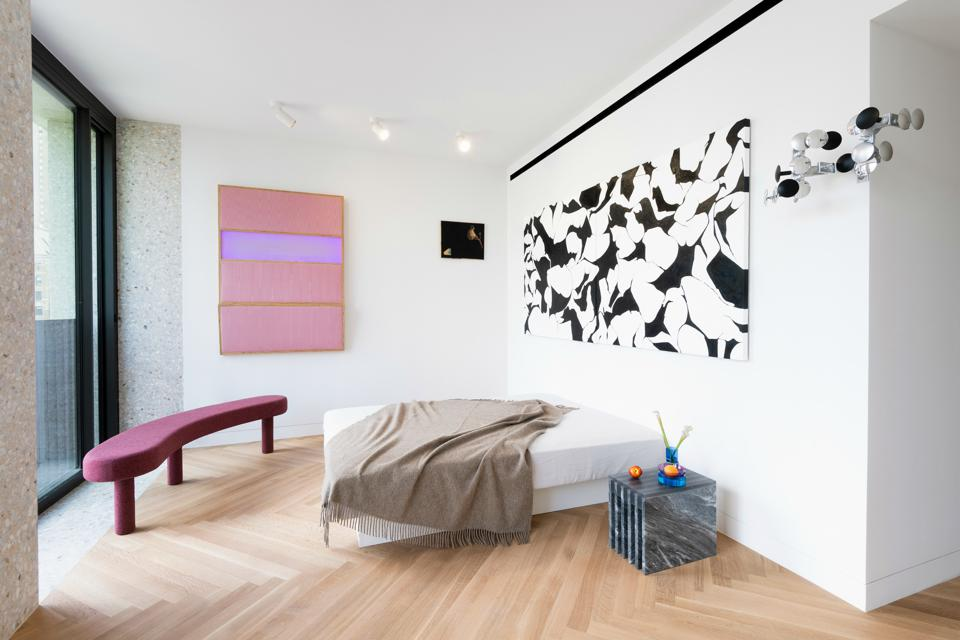 Pink and black-and-white art on display in an apartment.