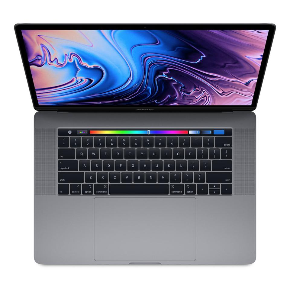 The Apple MacBook Pro 15 inch, showing the touch bar.
